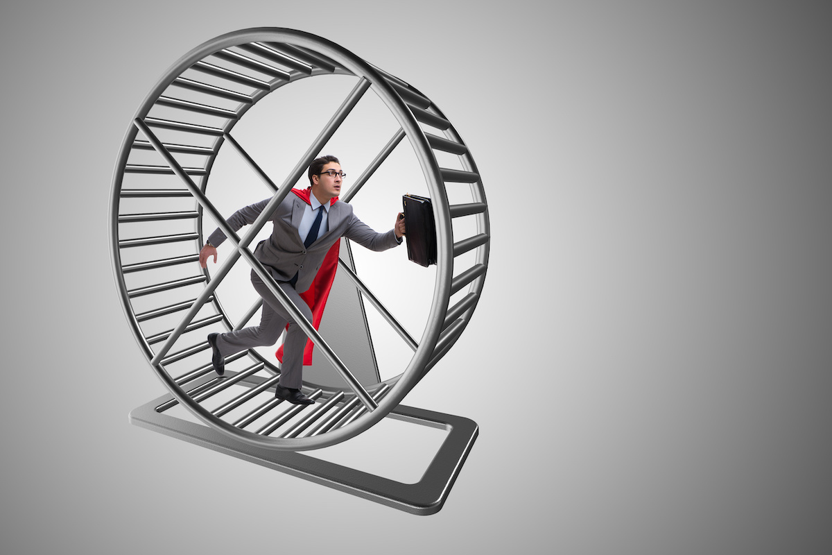 Businessman running on hamster wheel